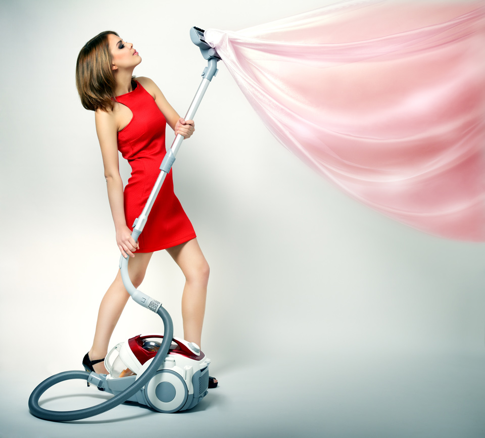 woman-cleaning-drapes-in-red-dress